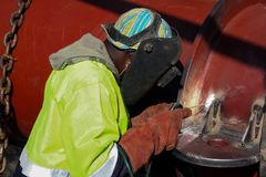 Man welding metal on a construction site, Tradesman working with stock photos