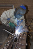 Man welding on production line Royalty Free Stock Photos
