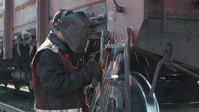 Man welding railway carriage stock video
