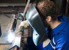Man welding steel creating many sparks Stock Images