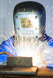 Man welding steel creating many sparks royalty free stock image