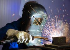 Man welding steel creating many sparks Royalty Free Stock Images