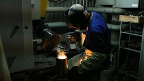 A man welding steel. On the part stock video