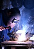 Man welding in a workshop. Man welding wearing protective clothing in a workshop, England, UK, Western Europe Stock Images