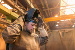 Man welding. Young man with protective mask welding in a factory Royalty Free Stock Image