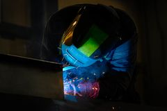 Man welds at the factory stock photo