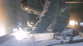 Man Welds Machine Components in Arctic stock footage