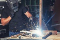 Man welds a metal  arc welding machine Stock Images