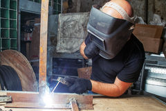 Man welds a metal  arc welding machine Royalty Free Stock Images