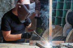 Man welds a metal  arc welding machine Stock Photos