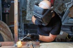 Man welds a metal  arc welding machine Stock Photo