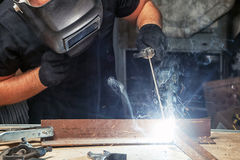 Man welds a metal  arc welding machine Stock Photography