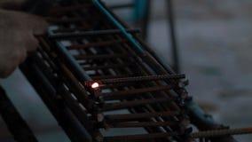 Man welds metal grid stock video footage
