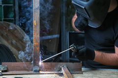 Man welds a metal welding machine Royalty Free Stock Photography