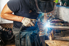 Man welds with a welding machine metal Royalty Free Stock Photography