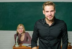 Man well groomed attractive teacher in front of classroom. Obsessed with knowledge. Teacher of her dreams. Handsome. Teacher. School and college education stock image
