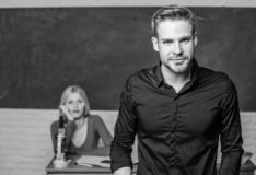 Man well groomed attractive teacher in front of classroom. Obsessed with knowledge. Teacher of her dreams. Handsome royalty free stock photography