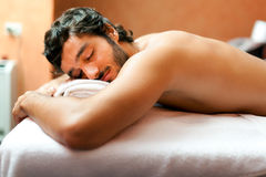 Man in a wellness center Royalty Free Stock Image