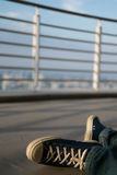 Man were sneaker sit on top of building Stock Image