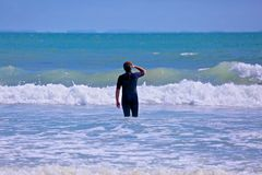 Man wetsuit ocean Stock Photography
