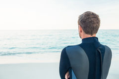 Man in wetsuit on a sunny day. Looking at sea Royalty Free Stock Image