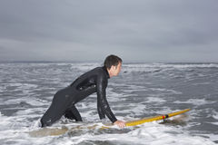 Man In Wetsuit Surfing At Beach Royalty Free Stock Photo