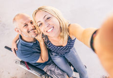 Man on wheel chair and his assistant Royalty Free Stock Photo