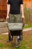 Man with wheelbarrow Royalty Free Stock Image
