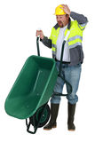 Man with a wheelbarrow Stock Photos