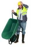 Man with a wheelbarrow Stock Photos
