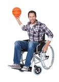 Man in wheelchair with basketball Stock Images