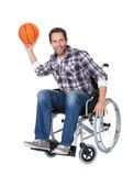Man in wheelchair with basketball Royalty Free Stock Image