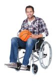 Man in wheelchair with basketball Stock Image