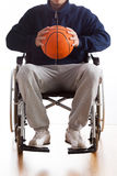 Man in wheelchair with basketball Royalty Free Stock Images