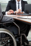Man on wheelchair during conversation Royalty Free Stock Photography