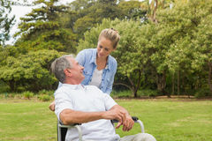 Man in wheelchair and daughter talking Stock Photos
