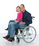 Man in wheelchair with daughter Stock Photos