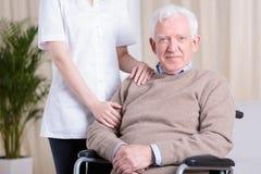 Man on wheelchair Royalty Free Stock Photo