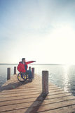 Man in wheelchair enjoying beach Royalty Free Stock Photography