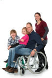 Man in wheelchair with family Royalty Free Stock Image