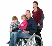 Man in wheelchair with family Stock Image