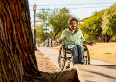Man in Wheelchair Gestures at Sidewalk Obstacle Stock Photos