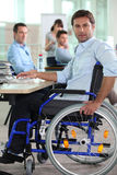 Man in wheelchair on laptop Royalty Free Stock Photos