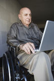Man In Wheelchair With Laptop Stock Photos