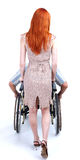 Man on wheelchair lead by woman Royalty Free Stock Image