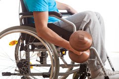 Man in wheelchair lifting weight royalty free stock photography