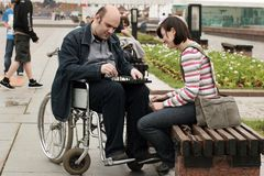 Man on a wheelchair in park Stock Image