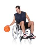 Man in wheelchair playing basketball Stock Photos