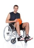 Man in wheelchair playing basketball Royalty Free Stock Images