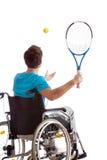Man in wheelchair playing tennis Royalty Free Stock Image